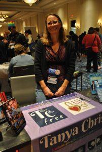 Photo of Tanya Chris at a table at GRL