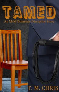 Cover of Tamed by T. M. Chris shows the back of a man in a suit holding a whip facing an empty wood chair