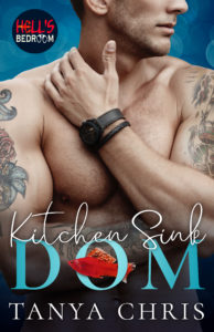 Cover for Kitchen Sink Dom by Tanya Chris shows a bare-chested man with colorful tattoos on both arms and leather wrist bracelets. A red fish swims through the O in Dom