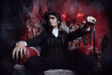mysterious man in tailcoat on a throne