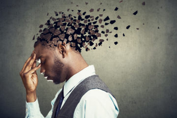 A Black man in a suit with the back of his head fragmenting off into separate pieces