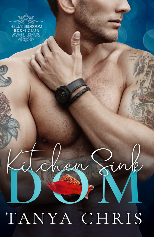 Cover for Kitchen Sink Dom by Tanya Chris shows a bare-chested man wearing leather wrist cuffs and both arms covered in tattoos. A red fish swims through the O in Dom